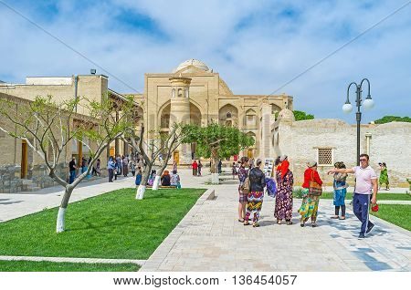 BUKHARA UZBEKISTAN - APRIL 29 2015: The pilgrims go to Khanaka of Abd Al-Aziz-Khan of Bahauddin Nakshband Memorial Complex on April 29 in Bukhara.