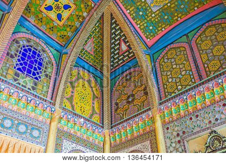 BUKHARA UZBEKISTAN - APRIL 29 2015: The ceiling in dining room of Sitorai Mokhi-Khosa Palace decorated with the stained glass screens covered with islamic patterns on April 29 in Bukhara.
