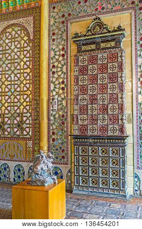 BUKHARA UZBEKISTAN - APRIL 29 2015: The tiled stove is built in wall of the dining room in Sitorai Mokhi-Khosa Palace on April 29 in Bukhara.