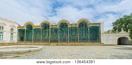 BUKHARA UZBEKISTAN - APRIL 29 2015: The richly ornamented covered wooden gallery of Sitorai Mokhi-Khosa Palace on April 29 in Bukhara.