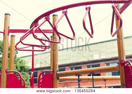 childhood, sport, equipment and object concept - climbing frame on playground outdoors at summer