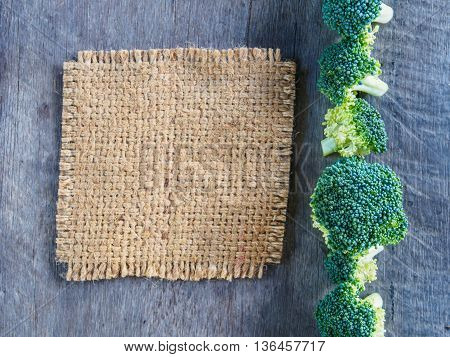 Broccoli and gunny on wooden with sack name plate