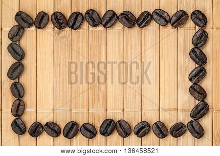 Frame Of Coffee Grains On A Bamboo Napkin