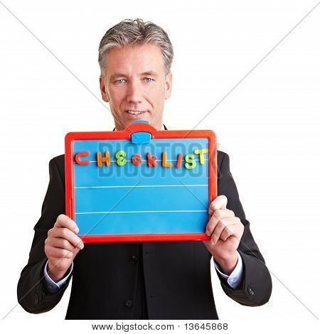 Business Man Showing Checklist