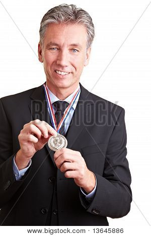 Business Man Showing Silver Medal