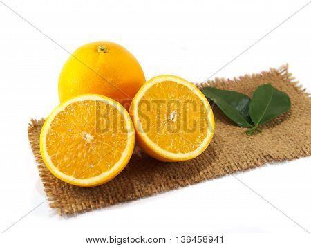 The orange fruit cutting on gunny of isolated