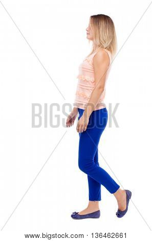 back view of walking  woman. beautiful blonde girl in motion.  backside view of person.  Rear view people collection. Isolated over white background. blonde in a pink jacket thoughtfully goes right