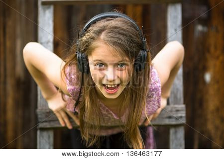 Expressive portrait of a little girl in the headphones.