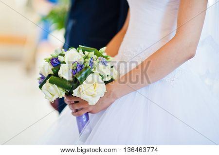Violet Wedding Bouquet On Hand Of Bride Background Groom