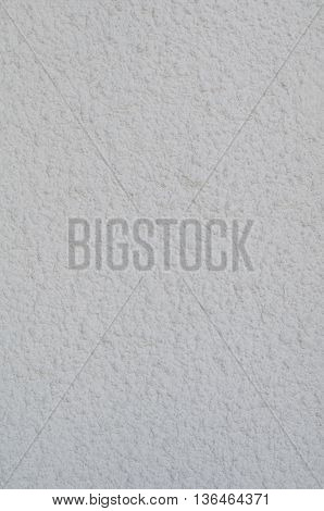 Background of a white stucco coated and painted exterior rough cast of cement and concrete wall texture decorative coating