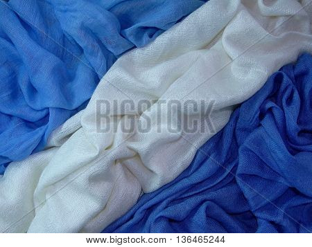three types of fabric are stacked in the crease, white blue colours