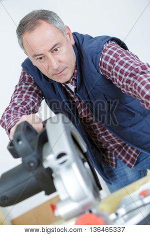 carpenter cutting wooden