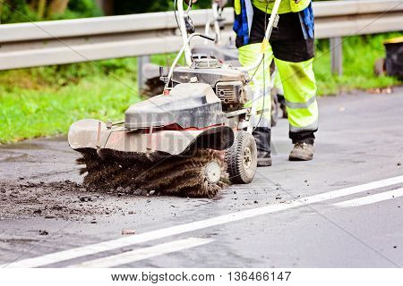 Worker Removes Upper Layer Of The Tarmac