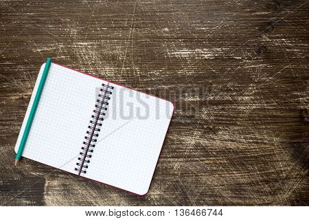 Open spiral notebook on the wooden background.Top viewcopy-space.