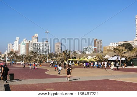 People Walking On Beach Front Promenade