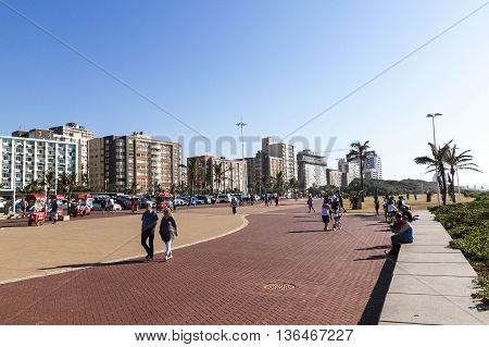Many Early Morning Beach Promenade Walkers