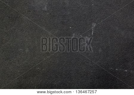 Grainy texture of dirty black sandpaper for carpentry.