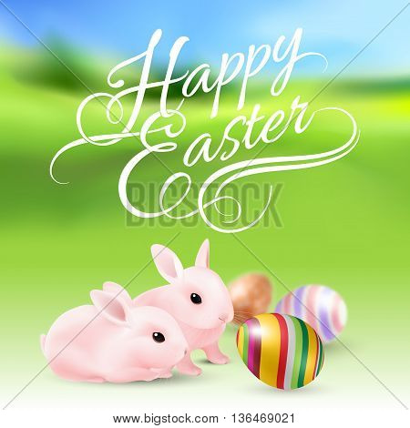 Two Easter Bunny and Easter Eggs in Green Grass