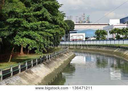 An industrial canal with industrial building as backdrop