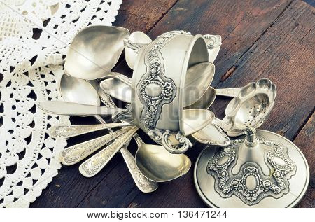 vintage old silverware on a wooden table