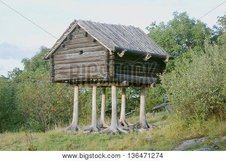 wooden hut on legs. Sweden park Skansen.