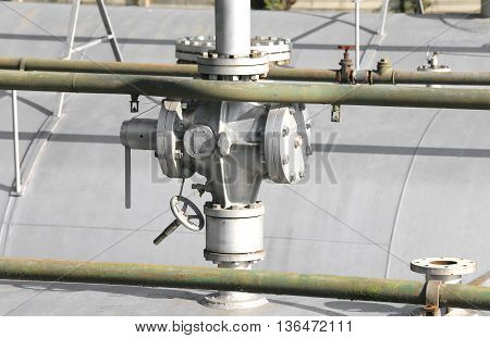 Big Ball Valve Above The Huge Gas Pressure Vessel In The System