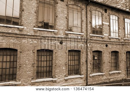Architectural Detail Of The Large Windows Of An Old Industrial B