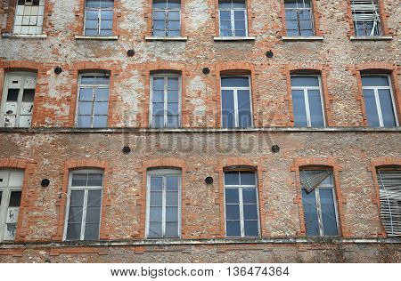 Industrial Building With Facing Bricks And Broken Windows