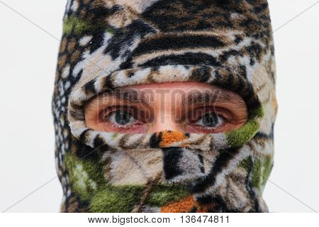 caucasian man with ski mask over white