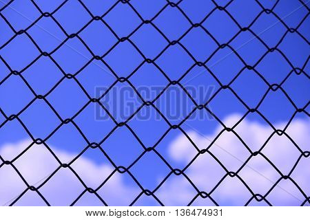 View blue sky with cloud background behind rusty grate - abstract background