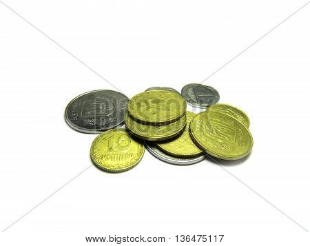 Several different coins of Ukraine on a white background.