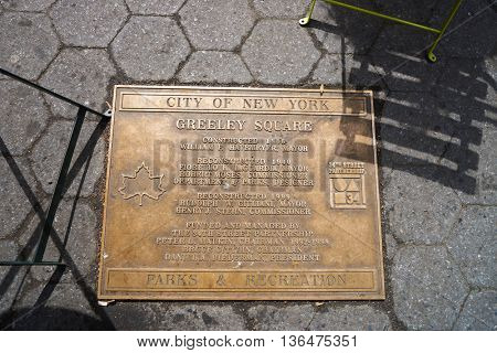 NEW YORK - CIRCA MARCH 2016: metal plate on Greeley Square in New York at daytime. The City of New York is the most populous city in the United States.