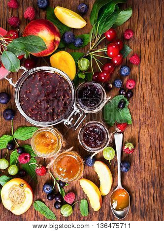 Jam Made From Different Berries In Glass Jars