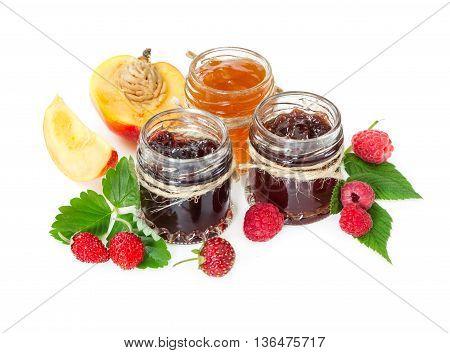 Jam In Glass Jars And Berries