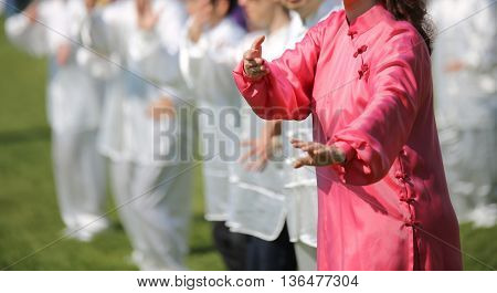 Woman With Pink Silk Dress Perform The Exercises
