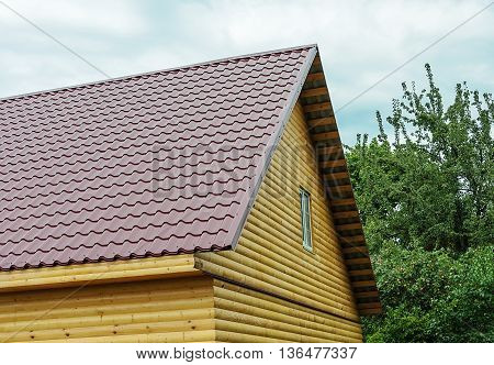 Tiled roof of new small country log house