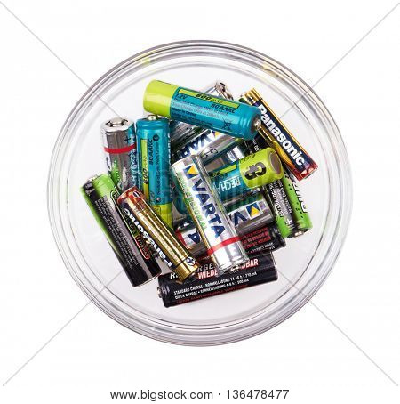 Group of batteries in cup, isolated on white background