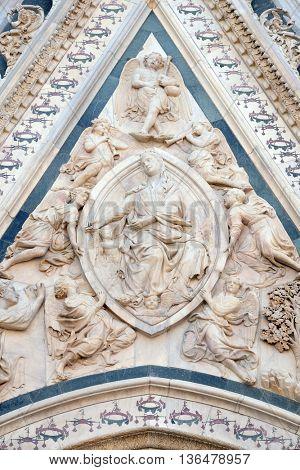 FLORENCE, ITALY - JUNE 05: Madonna of the Girdle, Portal of Cattedrale di Santa Maria del Fiore (Cathedral of Saint Mary of the Flower), Florence, Italy on June 05, 2015