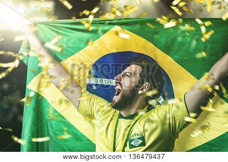 Brazilian player holding the flag of Brazil celebrating