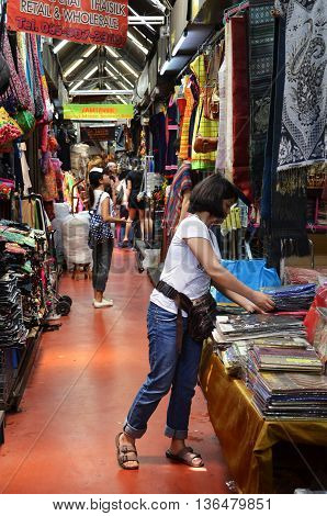 Tourist Shopping At Chatuchak Weekend Market In Bangkok, Thailand