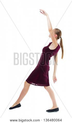 Balancing young woman.  or dodge falling woman. Rear view people collection.  backside view of person.  Isolated over white background. Blonde girl in a burgundy dress falls on his back.