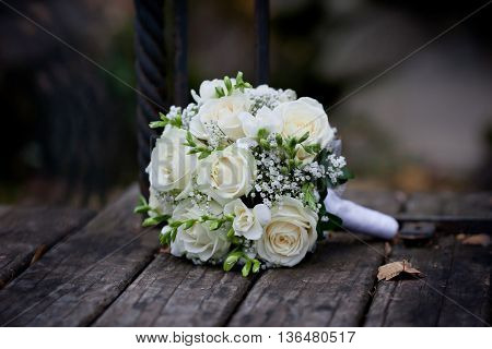 White Rose Bouquet on the wooden background