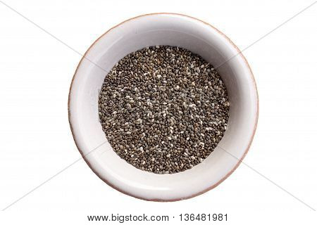 Chia seeds in a white bowl isolated on white