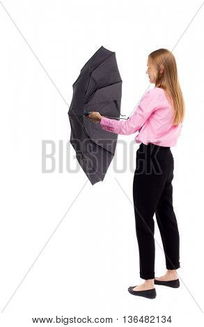 young business woman with umbrella. Rear view people collection.  backside view of person.  Isolated over white background. Woman office worker in a pink shirt open black umbrella.