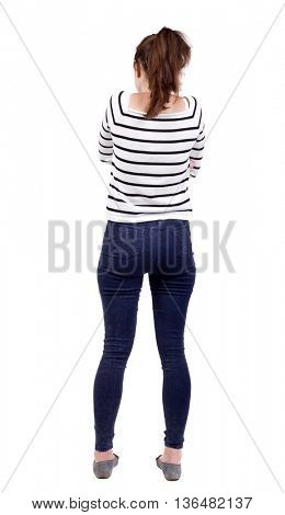 back view of standing young beautiful  woman.  girl  watching. Rear view people collection.  backside view of person.  Isolated over white background. Girl in white striped blouse standing arms folded