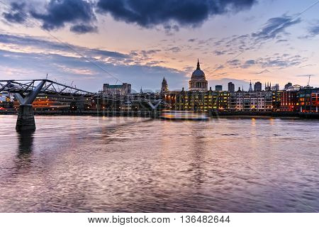 Night photo of St Paul's Cathedral and Millennium Footbridge over the Thames, London, England, Great Britain