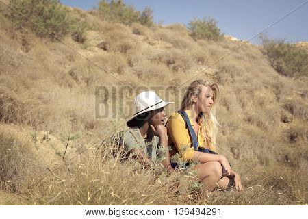 Girls hiking in a hot day