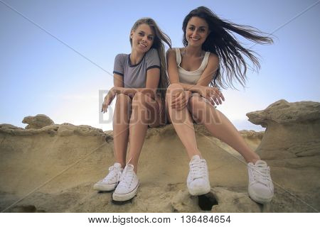 Girls sitting on a rock