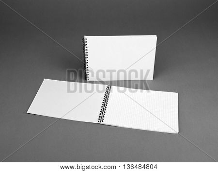 Blank spiral notebook on gray background. Template for your design