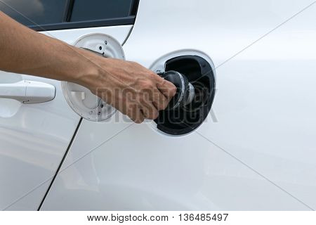Hand opening the oil filler cap,  engine, pump, diesel